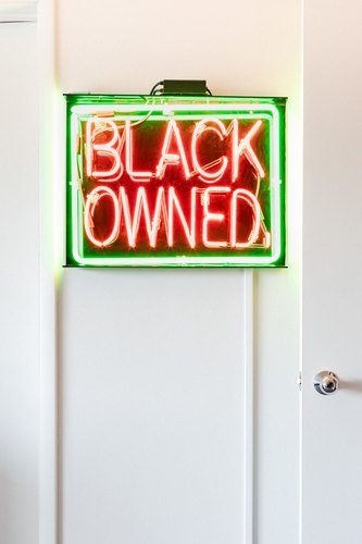 Black Owned neon sign by Patrick Martinez