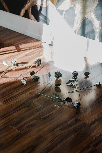 Handmade steel roses by artist Aaron Sadnes scattered on hardwood floor