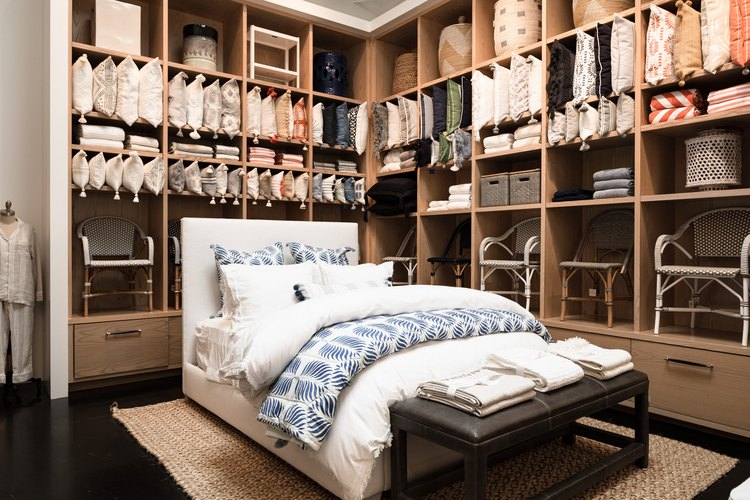 bed surrounded by shelves with decor products