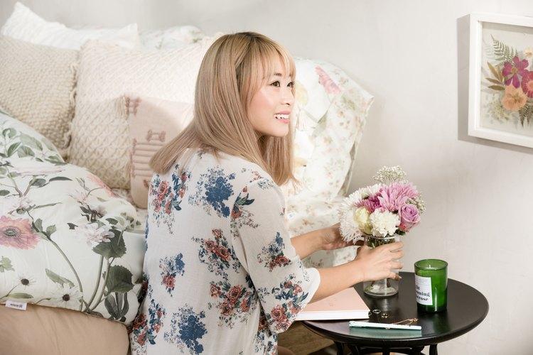 Aileen Xu in floral bedroom