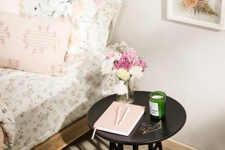 Floral bedding and night table