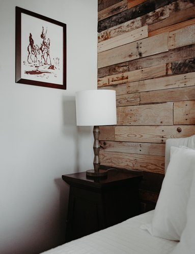 Bedside table with reclaimed wood wall