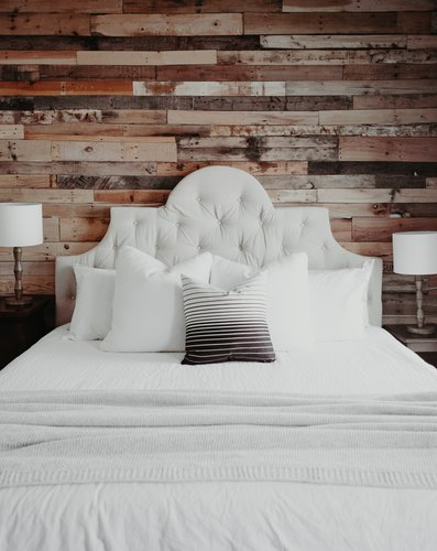 Bedroom with reclaimed wood wall
