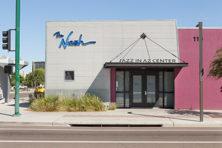A gray-pink business with blue signage