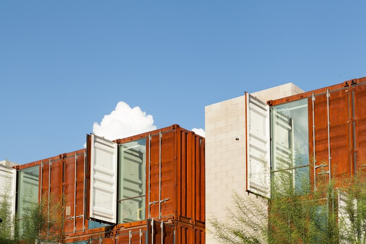 Brown shipping container buildings with trees