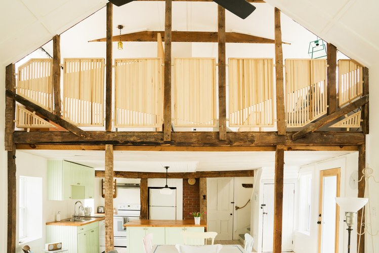 a kitchen is visible through a half-timbered atrium