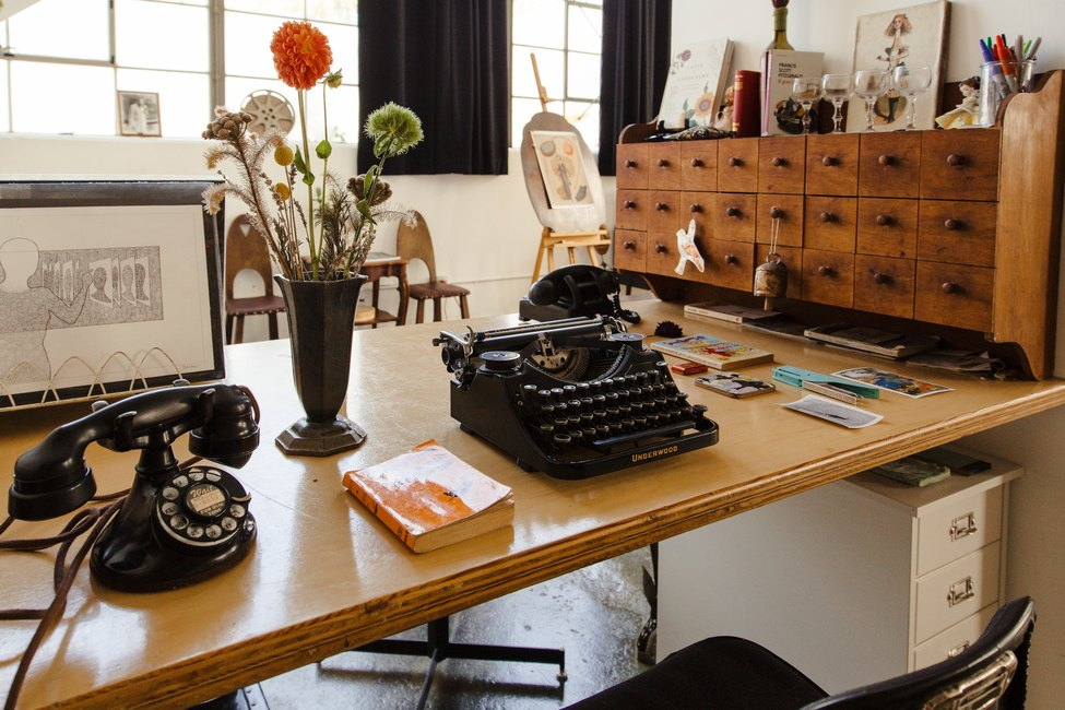desk with typewriter and phone